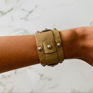 Tan leather bracelet with silver detail.